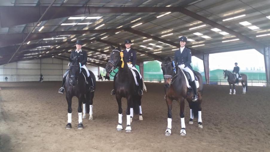 Three winning riders on their horses.