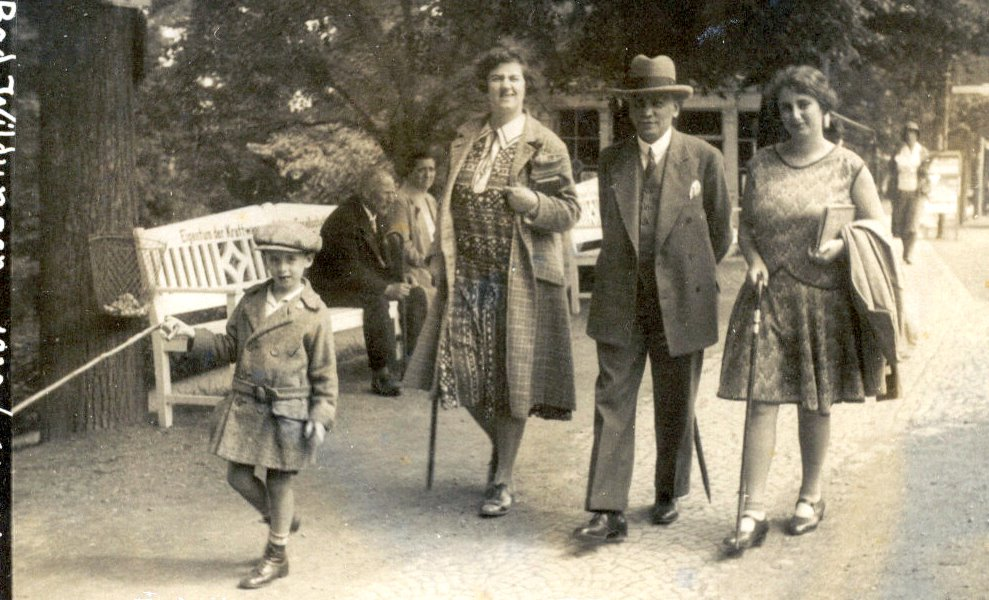 At left, with his family in Germany, 1930