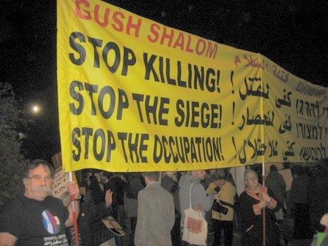 hoisting the big Gush Shalom transparent