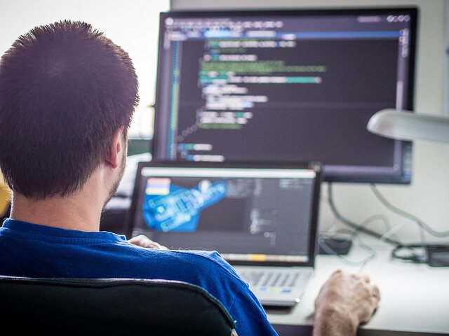 picture of a game programmer at work by Sergey Galyonkin
