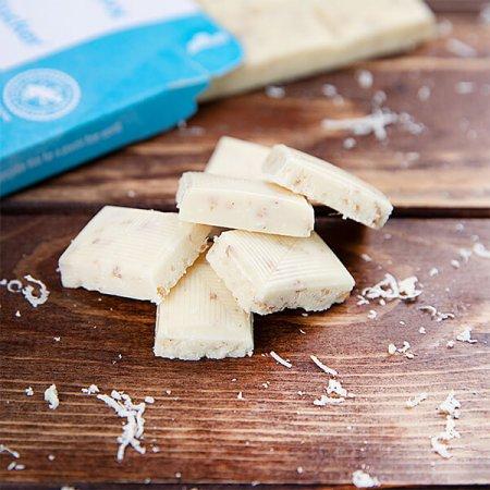 Weiße Xylit-Schokolade mit Kokos und Weizenflakes 100 gr. Tafel. Vollmilch Schokolade ohne Zucker kaufen. Zuckerfreie Schokolade kaufen. Xukkolade kaufen.