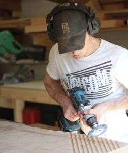 Woodworker in shop with tools