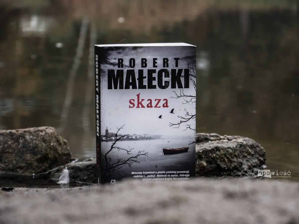 Zatracenie | Robert Małecki, Skaza