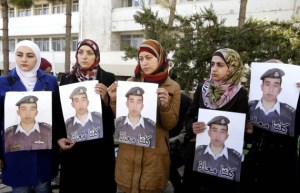 Anwar al-Tarawneh, center, the wife of Jordanian pilot, Lt. Muath al-Kaseasbeh, who is held by Islamic State in Jordan, Al-Kaseasbeh was seized after his F-16 jet crashed in Syria