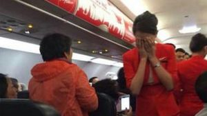 Chinese couple forced a plane to turn back when they allegedly attacked a flight attendant with scalding hot water, then threatened to blow up the plane