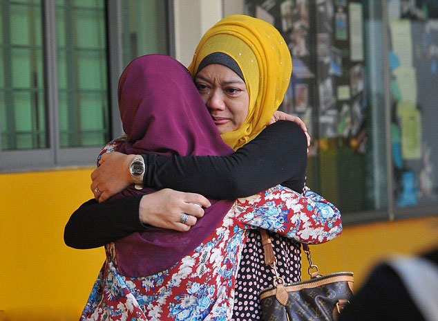 Family-members-of-students-from-Tanjong-Katong-Primary-School-embrace-in-tears-in-memory-of-the-victims-from-the-school-involved-in-the-earthquake