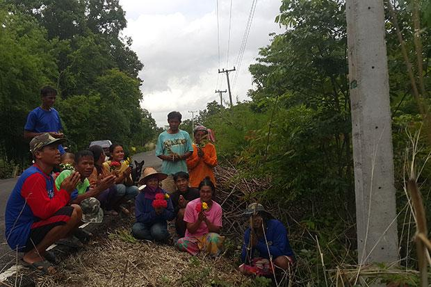 Villagers from Ban Kum in Khong Chiam district of Ubon Ratchathani pray at the base of a utility pole that has not delivered any electricity