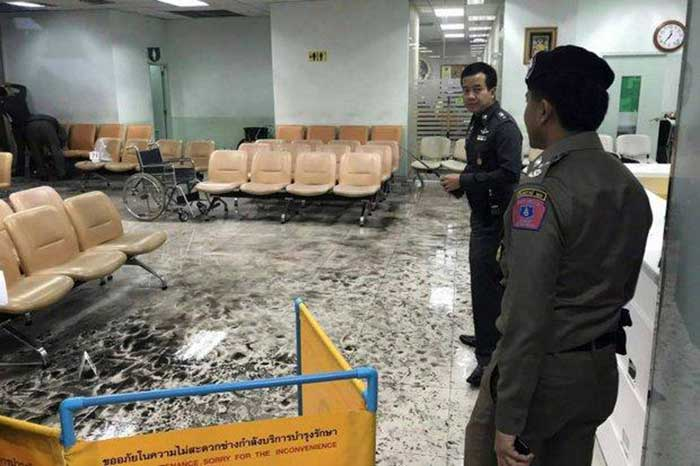Police examine the scene on on the first floor of Phramongkutklao Hospital in Ratchathewi district, where 25 people were wounded, one critically, by the bomb