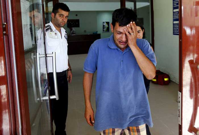 Abdullah-Kurdi,-the-father-of-the-two-Syrian-refugees-found-washed-up-on-a-beach,-arrives-at-a-morgue