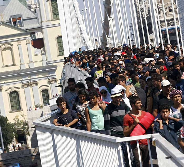 Migrants-cross-the-Erzsebet-bridge-in-Budapest,-Hungary,-as-they-head-for-Austria-on-foot-after-not-being-allowed-to-travel-by-train