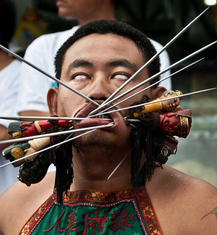 face-pierced-chinese-monk-at-vegetarian-festival-in-phuket-thailand
