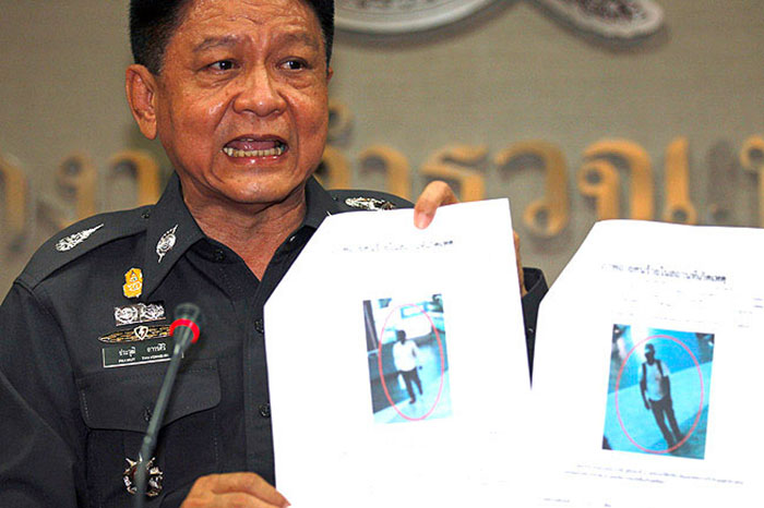Thai police Lieutenant General Prawut Thavornsiri shows pictures of what the police say are two suspicious-looking people caught on CCTV footage whom they are trying to identify in relation to the bombings outside Siam Paragon mall, during a news conference at the Royal Thai Police headquarters in Bangkok February 4, 2015.