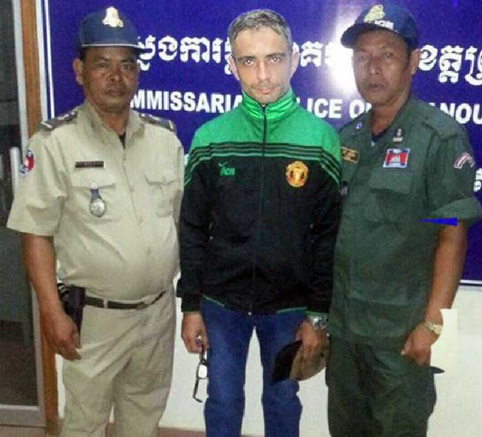 A-man-identified-as-murder-suspect-Artur-Segarra-with-Cambodia-police-in-Sihanoukville-province