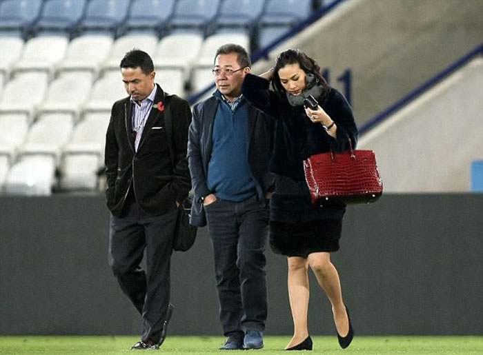 Khun-Vichai-(centre)-leaves-the-King-Power-Stadium-by-helicopter,-which-lands-in-the-centre-circle