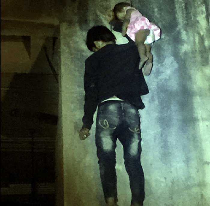 Father hangs his 11-month-old daughter