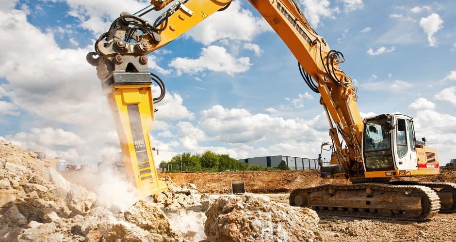 Industriefotografie Abrissbagger auf Baustelle