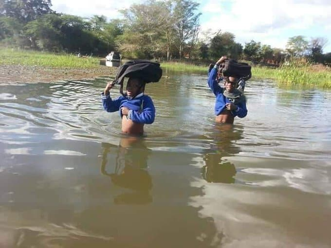 Heart breaking pictures: South African poor school kids cross flooded river on foot