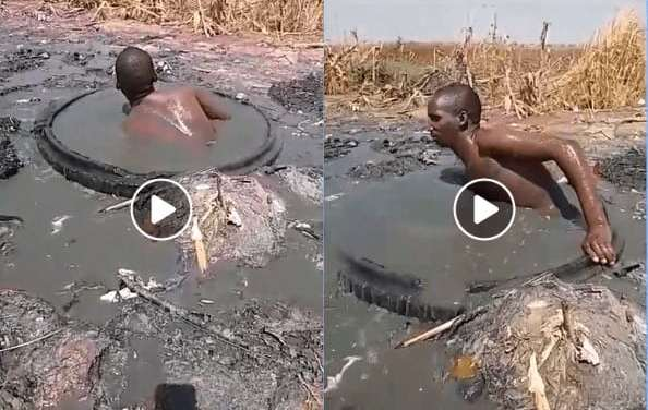 VIDEO: Naked Zimbabwean man dives into sewage pool to unblock line