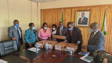 Government hands over laptops to institutions of higher learning