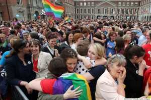 Supporters react outside Dublin Castle following the announcement of the result of the same-sex marriage referendum in Dublin on May 23, 2015. Ireland on Saturday became the first country in the world to approve gay marriage by popular vote as crowds cheered in Dublin in a spectacular setback for the once all-powerful Catholic Church.    AFP PHOTO /  PAUL FAITH        (Photo credit should read IAN KINGTON/AFP/Getty Images)