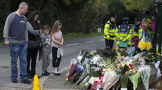 11/10/2015. Scenes At Halting Site Fire In Carrickmines. A family pay their respects to the 10 people who died in a fire tragedy on a halting site on Glenamuck Road in Carrickmines in South County Dublin. Photo: RollingNews.ie