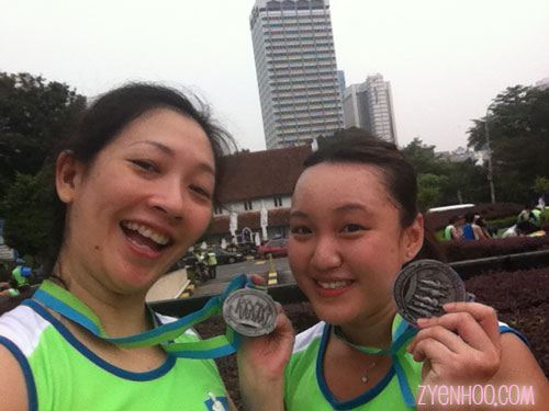 Audrey and I with our finisher medals. We iz awesome like dat!