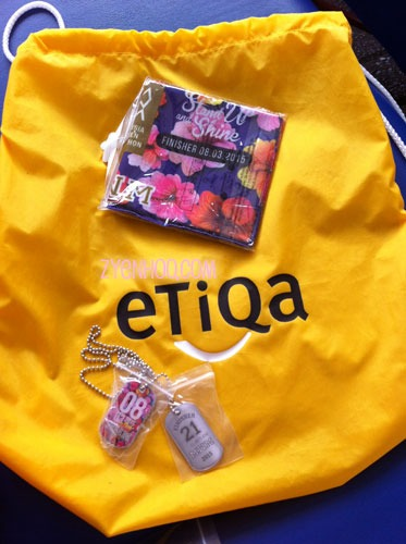 The finisher bag for half-marathoners. Includes the finisher tags and a finisher head buff