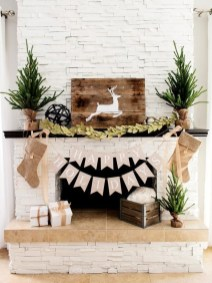 Creative Rustic Christmas Fireplace Mantel Décor Ideas 04