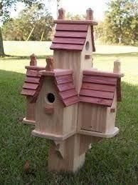 Elegant Bird House Ideas For Your Backyard Space35